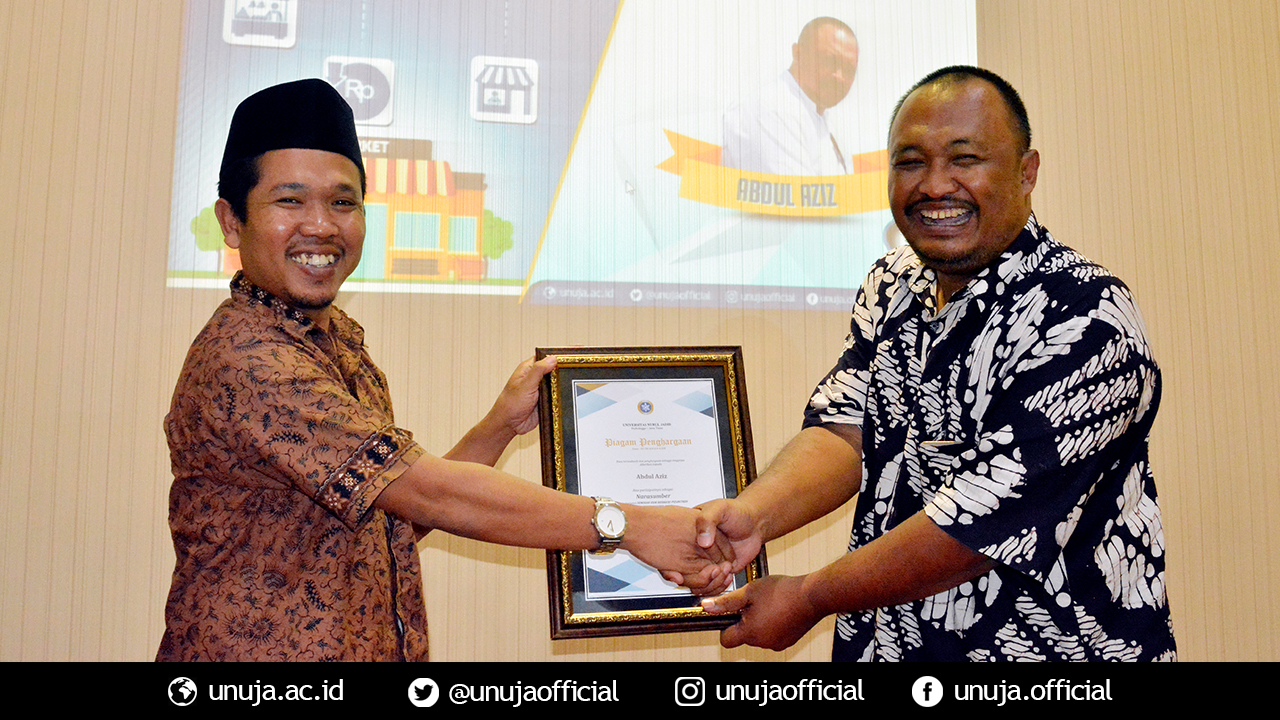 Vice Rector III gives a souvenir to Bapak Aziz as a keynote speaker